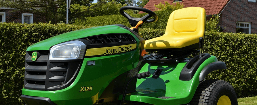 A riding mower on the lawn, possibly financed.