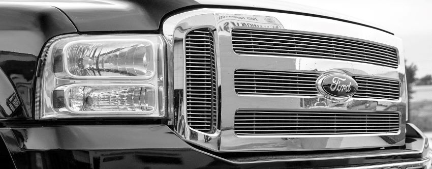 The grill of a Ford truck that needs a truck part.